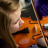 Globe/Roger Nomer<br /> Sydney Condreay, sophomore, practices on Thursday with the Neosho High School orchestra.
