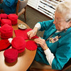 Globe/Roger Nomer<br /> Betty Nolin, a volunteer at Freeman, pins a baby cap during a knit in for the Little Hats Big Hearts program on Thursday at Freeman Hospital. Freeman and the American Heart Association partnered to provide every baby born in February at Freeman a red hat, as part of American Heart Month.