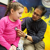 Globe/Roger Nomer<br /> Enrico Esguerra, pediatrician, gives a check up to Kiley Jones, 6, Joplin, on Wednesday at Access Family Care.