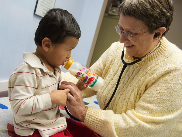 Globe/Roger Nomer<br /> Debbie Smith, a family nurse practitioner, gives a check up to Jacob Thomas, 2, Carthage, on Wednesday at Access Family Care.