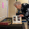 Globe/Roger Nomer<br /> Former Royal Heights secretary Jean Donoho, Diamond, looks through photo books during the 100th birthday celebration on Monday at Royal Heights Elementary.