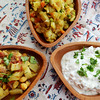 From left to right: Aloo Chole, Samosa side, and Raita were all inspired by Indian dishes but have been revamped to cut fat and calories.