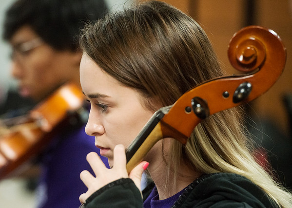 Globe/Roger Nomer<br /> Allie Barber, sophomore, practices on Thursday with the Neosho High School orchestra.