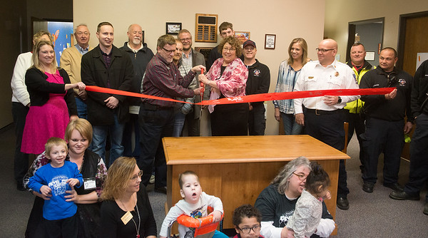 Globe/Roger Nomer<br /> Christy Graham, executive director of Cerebral Palsy of Tri-County, and Brad Baker, board president, cut a ribbon in honor of the center's 60th birthday on Friday in Webb City.