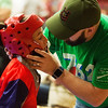 Globe/Roger Nomer<br /> Jared Pentecost, Springfield, gives some last-minute encouragement to his son Nehemiah, 10, on Saturday during the Joplin Eye of the Storm Invitational Karate Tournament at Memorial Hall.