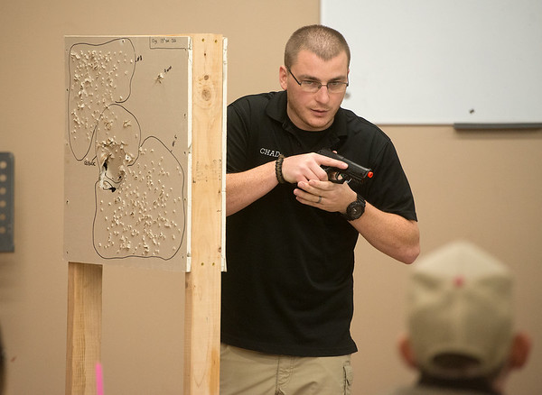Globe/Roger Nomer<br /> Chad Harris talks about situational awareness during a concealed carry class on Thursday at Liberty Tree in Carthage.