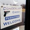 Globe/Roger Nomer<br /> Guns welcome sign at Orient Express, Webb City.