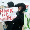 Globe/Roger Nomer<br /> Mary Gaarder, Joplin, holds a sign in support of the Affordable Care Act during a protest on Tuesday at 32nd and Rangeline.
