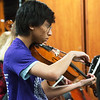 Globe/Roger Nomer<br /> Baranpas Jesse, senior, practices on Thursday with the Neosho High School orchestra.