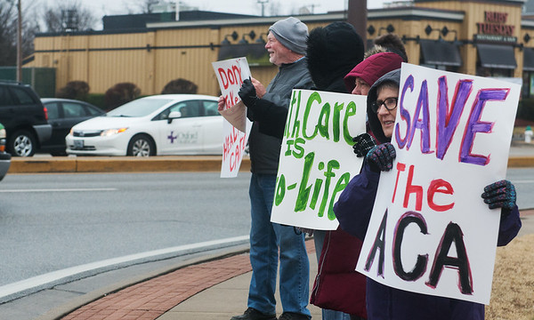 Globe/Roger Nomer<br /> Joan Banks, Joplin, holds a sign supporting the Affordable Care Act during a protest on Tuesday at 32nd and Rangeline.