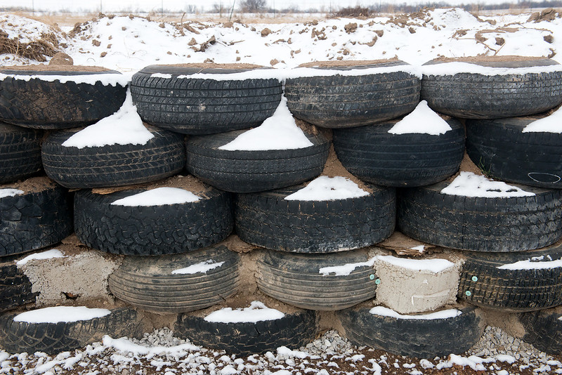 Globe/Roger Nomer Jimmie Carter is using tires for the interior walls of his house near Jasper.