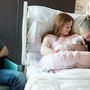 Globe/Roger Nomer<br /> Linda Parnell, Wyandotte, gives her great granddaughter Ellie Matthews a kiss on Monday while visiting her at the Mercy Birthing Center. The baby was born to Cody and Shelby Matthews, pictured, on Jan. 2 at 8:42 a.m., the first baby born at Joplin Mercy Hospital. The parents received a gift bag including a car seat from the hospital.