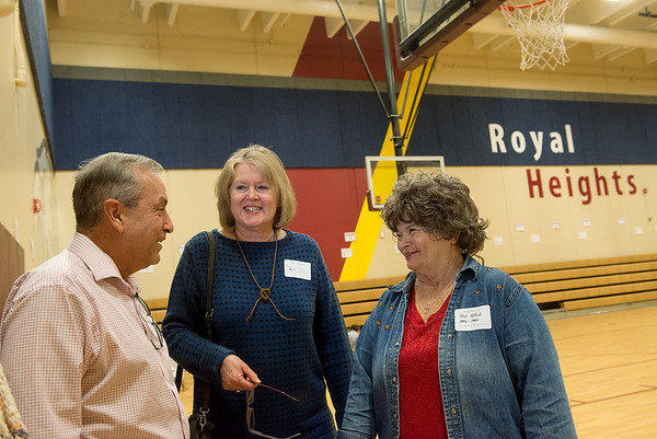 Globe/Roger Nomer<br /> Former Royal Heights students (from left) Michael Roland, Joplin, Jane Galbraith, Springdale, and Pat Alford, Joplin, talk during the 100th birthday celebration on Monday at Royal Heights Elementary.