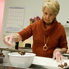 Globe/Roger Nomer<br /> Claudia Ketron dips truffles on Thursday at Sweet Emotion Chocolate Boutique.