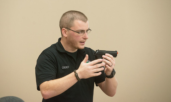 Globe/Roger Nomer<br /> Chad Harris talks about handgun selection during a concealed carry class on Thursday at Liberty Tree in Carthage.