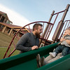 Globe/Roger Nomer<br /> Chris, Taylor and Remington, 11 months, Mootrey play on the equipement at Copper Point Landing on Monday. The family has lived at the apartments for about a month.