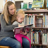 Globe/Roger Nomer<br /> Terryn Bollinger, Seneca, reads to her daughter Lakin, 2, on Thursday at the Seneca Public Library.
