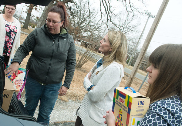 Globe/Roger Nomer<br /> (from left) Brandy Corum delivers toys to Vickie Dudley, executive director at the Children's Center, and Aryn Crawford, child advocate, on Tuesday at the center.