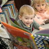 Globe/Roger Nomer<br /> McCoy Hembree, 3, Seneca, reads along on Thursday during storytime at the Seneca Public Library.