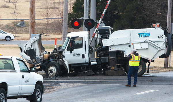 Globe/Roger Nomer<br /> Fourth Street remains closed after a collision between a street sweeper and a train on Thursday morning.