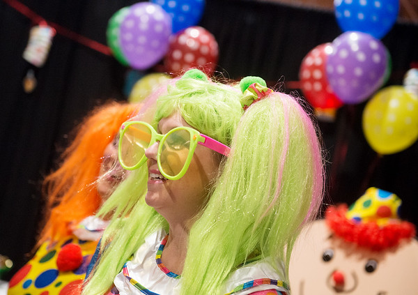 Globe/Roger Nomer<br /> Laura Dobbs, loan officer at Joplin Metro Credit Union, dresses as a clown on Tuesday for the birthday party theme of the Joplin Business Expo at Downstream Casino.