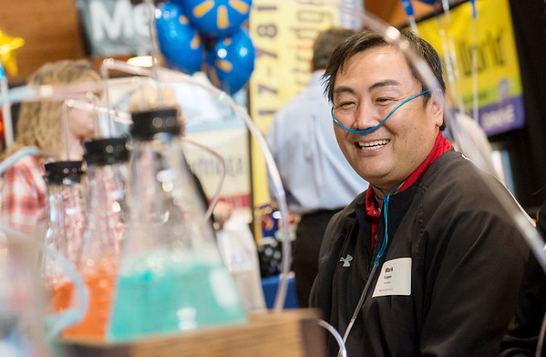 Globe/Roger Nomer<br /> Mark Turpen, territory manager with Heartland Payment Systems, tries out an oxygen bar from Skaggs Chiropractic on Tuesday at the Joplin Business expo. The oxygen bar demonstrates a small effect of the business's hyperbaric chamber.