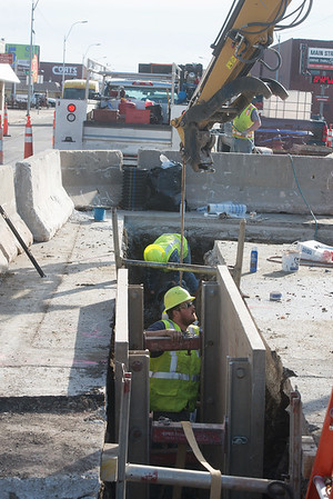 Globe/Roger Nomer<br /> Work continues on water pipes at 16th and Main in Joplin on Tuesday afternoon.