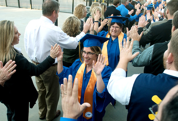 Globe/Roger Nomer<br /> Graduates of Walmart Academy enter their graduation celebration on Tuesday at Walmart store #59 on Range Line. This was the first graduating class for the Joplin store's academy, which had 64 graduates.