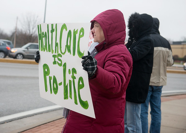 Globe/Roger Nomer<br /> Ellen Broglio holds a sign in support of the Affordable Care Act during a protest on Tuesday at 32nd and Rangeline.
