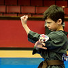 Globe/Roger Nomer<br /> Trenten Alexander, 8, Troy, demonstrates his skill for the judges on Saturday during the Joplin Eye of the Storm Invitational Karate Tournament at Memorial Hall.