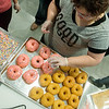 Globe/Roger Nomer<br /> Sara Ferris practices decorating Homer Simpson donuts on Monday at Hurts Donuts.