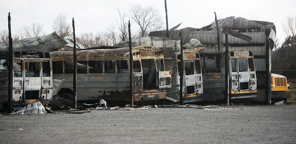 Globe/Roger Nomer<br /> Fire struck the Wyandotte Public Schools bus barn late Wednesday night destroying ten school buses and forcing the cancellation of school on Thursday and Friday.