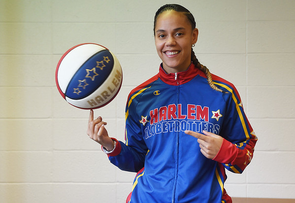 "Briana ""Hoops"" Green spins a basketball.<br /> Globe 