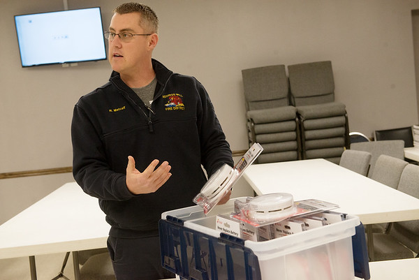 Ronnie Metcalf, deputy chief of the Redings Mill Fire Protection District, talks about free smoke detectors available from the District on Wednesday.<br /> Globe | Roger Nomer