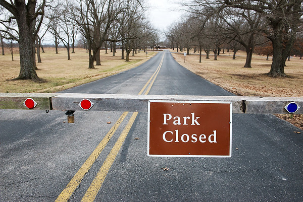 Globe/Roger Nomer<br /> A sign announces the closure of the Carver National Monument on Monday.
