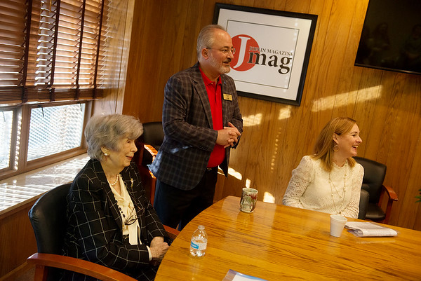 Frank Leto, publisher of the Joplin Globe, addresses those honored as JMag Pathfinders, including Ethelmae Humphreys, chairman of the board at TAMKO, left, and Louise Secker, development director at Lafayette House, right, on Tuesday during a breakfast at the Globe.<br /> Globe | Roger Nomer