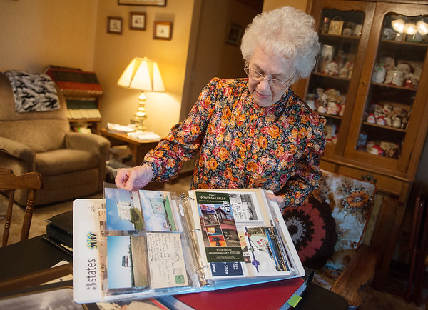 Charlyn Hubbard talks about her collection of historic postcards on Wednesday afternoon.<br /> Globe | Roger Nomer