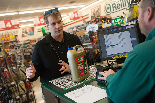 Tristan Twitchell talks with Keith Hembree, salesman at O'Reilly's Auto Parts, as he buys antifreeze on Tuesday at the store.<br /> Globe | Roger Nomer
