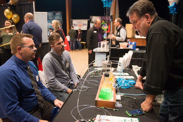 Steven Skaggs, owner and chiropractor at Skaggs Chiropractic, right, talks with Josh Grissom, left, and Cade Earp as they partake of an oxygen bar on Tuesday at the Joplin Business Expo at Downstream Casino.<br /> Globe   Roger Nomer