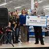 Globe/Roger Nomer<br /> To celebrate the completion of the store remodel, Sam's Club gave away around $90,000 to six different area organizations on Friday. Robert Thomas, club manager, gives a check to Heather Lesmeister, program director of Children's Miracle Network Hospitals, for $78,317 raised by the store. That marks the largest amount raised by a single Sam's Club for a charity in the nation.