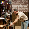 Globe/Roger Nomer<br /> Jesse DeLeon, lead brewer, talks about the brewing tanks at Downstream Casino on Thursday.
