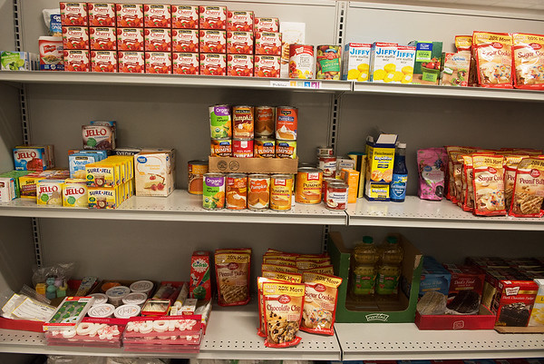 Donations like those from Restaurant Week help keep the shelves stocked at Crosslines.<br /> Globe   Roger Nomer