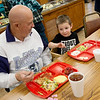 Lee Hall Jr. eats lunch with his great grandson Knox, 3, at the Wyandotte Nation Community Center on Wednesday.<br /> Globe | Roger Nomer