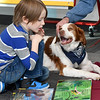 "Six-year-old James Carter reads to ""Brooks,"" Tom Kearney's Brittany during Dog Day Afternoon on Tuesday afternoon at the Joplin Public Library. <br /> Globe 