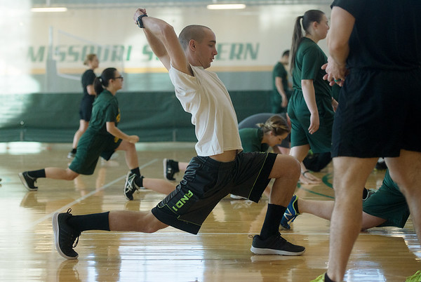 Joshua Norris, a Missouri Southern freshman from Joplin, warms up during the PT with the Missouri National Guard event on Saturday at the Billingsly Student Center.<br /> Globe | Roger Nomer