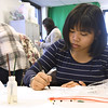 Jharry Gumabon, of Cassville, participates in a fused glass nightlight workshop on Saturday at the Spiva Center for the Arts. Gumabon was given the workshop as a birthday present and joined a full class of 15 for the event.<br /> Globe | Laurie Sisk