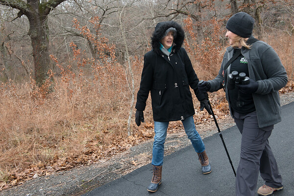 Mary Gaarder, left, talks with Robin Standridge during Tuesday's First Day Hike at Wildcat Glades.<br /> Globe | Roger Nomer