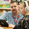 David Meinershagen works with Rayce Straughn as he substitutes in the first-grade classroom at Webster Elementary on Wednesday.<br /> Globe | Roger Nomer