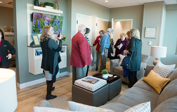 Visitors tour the newly-opened Ronald McDonald Family Room at Mercy Hospital on Tuesday afternoon. The room provides a place for families to rest and relax while staying near their children at the hospital.<br /> Globe | Roger Nomer