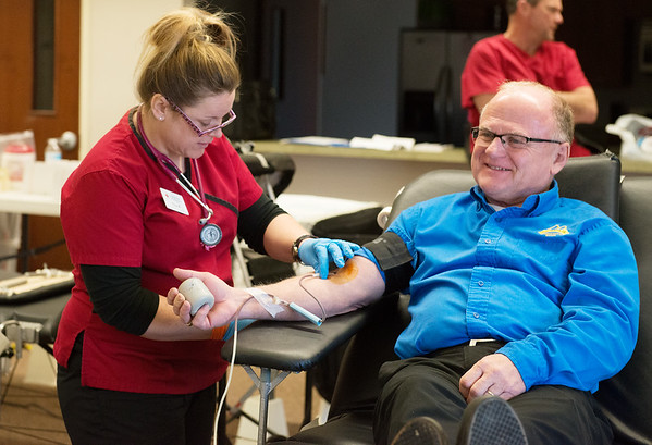 Globe/Roger Nomer<br /> Tila Ashley, collections technician with the American Red Cross, collects a donation from Wes Irvin, Seneca, on Monday during a blood drive at Hideout Harley-Davidson.